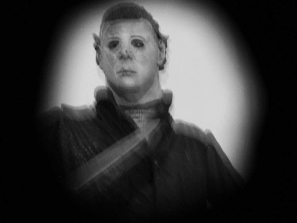 I Took The Images Of Crow And Michael Myers Figurines Inside In Artificial Light These Sit On A Shelf To Side Living Room So