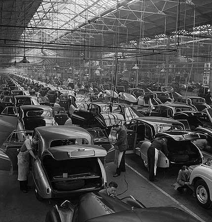 An elevated view looking down onto the Sapphire car production line at the Armstrong Siddeley car and aircraft engine works 1954 © English Heritage.NMR
